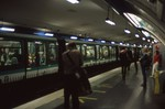 "Alesia station - Paris Metro (note ""open gangway""-style train, without dividers between cars)"