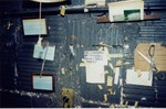 Operators' licenses and city inspection certificate above rewind bench (August, 2002)