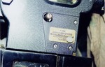 City fire inspection plate on one projector (August, 2002)