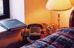 my bedside phone:  an ITT 3568 16-button Autovon set (note extra column for ABCD buttons used to indicate priority of call)