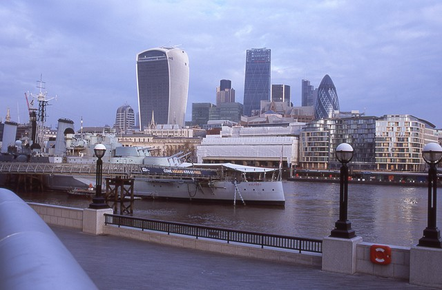Downtown London with battleship in foreground