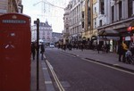 tourists and red telephone booth