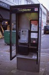 non-red telephone booth with telephone